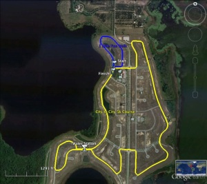 Gentle hilly course surrounded by lakes and orange groves.